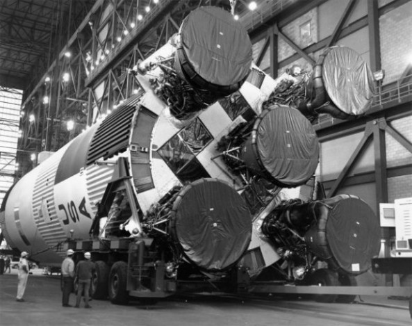 Workers make preparations to the S-IC first stage rocket in the the Vehicle Assembly Building.