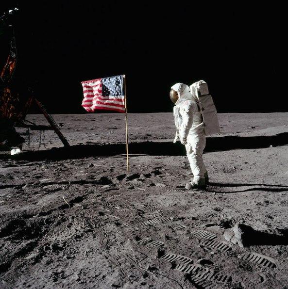 Buzz Aldrin salutes U.S. Flag.