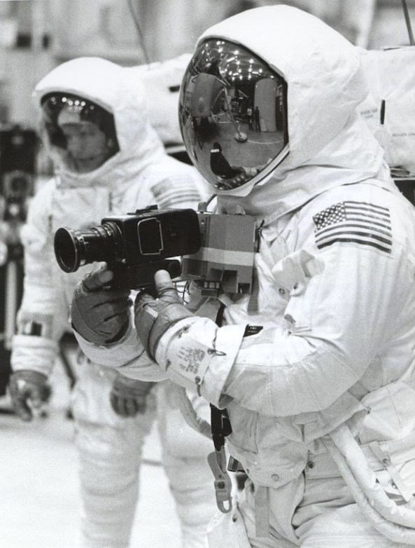 Buzz Aldrin practices Hasselblad photography as Neil Armstrong looks on