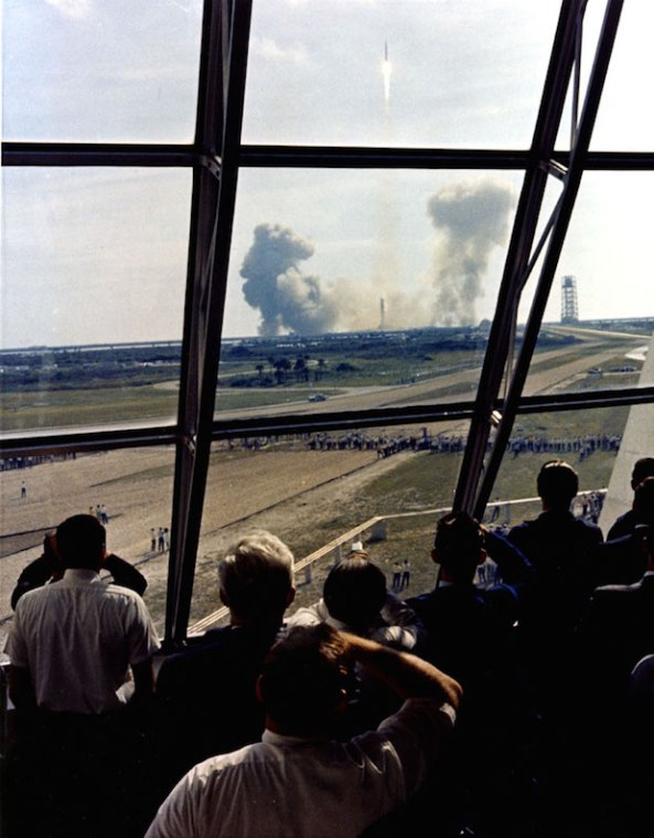 Launch team members view the Apollo 11 through the firing room windows.