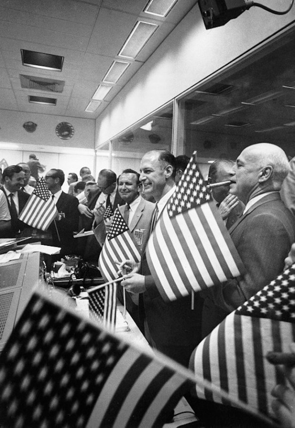 Mission control celebrates Apollo 11's safe return.
