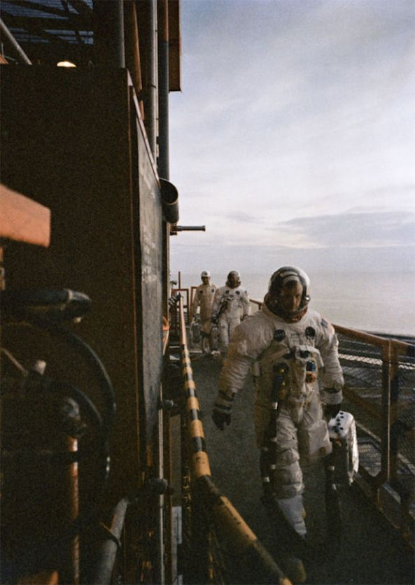 The crew of Apollo 11 take their final steps on Earth before stepping foot into the vehicle that would take them to the moon.