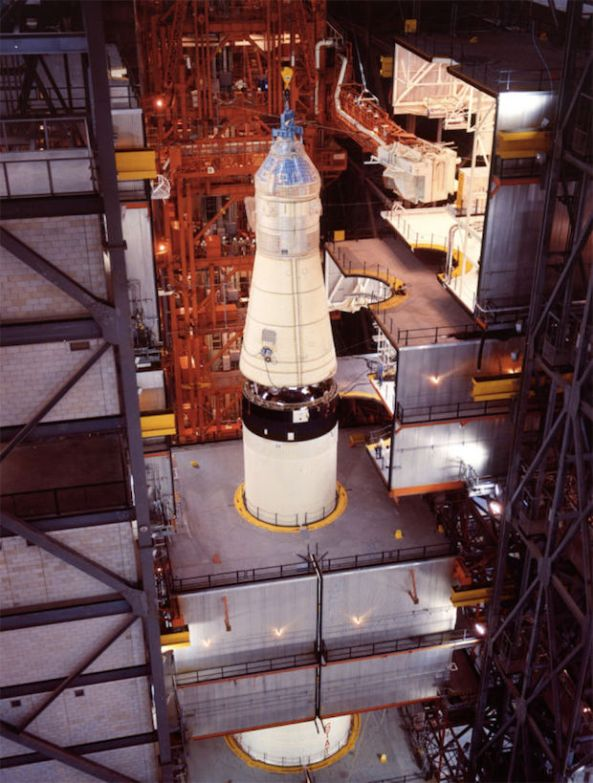 The attaching of the Apollo 11 spacecraft to the Saturn V launch vehicle.
